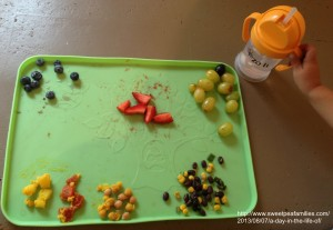 a sample of T's placemat: blueberries, strawberries, grapes, black beans & corn, chickpeas, tomatoes, & yellow carrots.