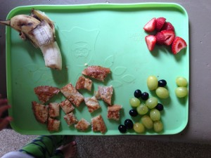 half a banana, french toast on local/organic whole wheat bread, grapes & strawberries