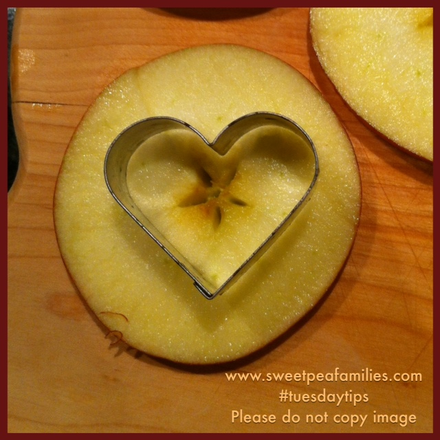 Make star-centered hearts by centering the shape cutter on the apple.